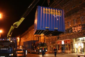 container being lowered into position